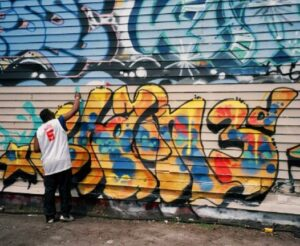 An image showing graffiti artist, Chain 3, at work
